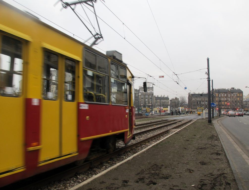 Tram speeding past in Praga in Warsaw, Poland