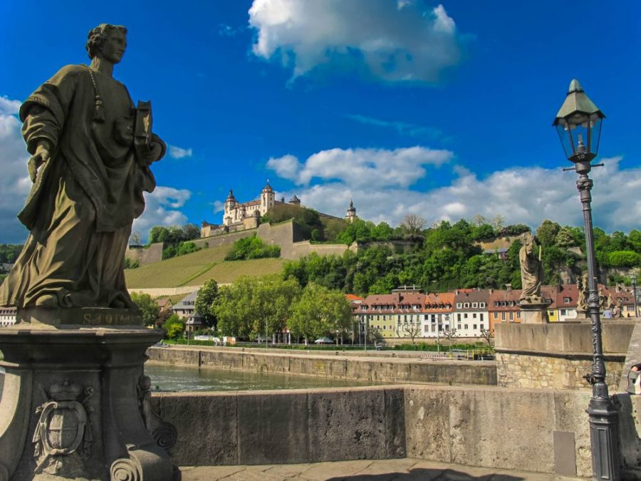 Scenes From Alte Mainbrücke in Würzburg with the Marienberg Fortress in the background