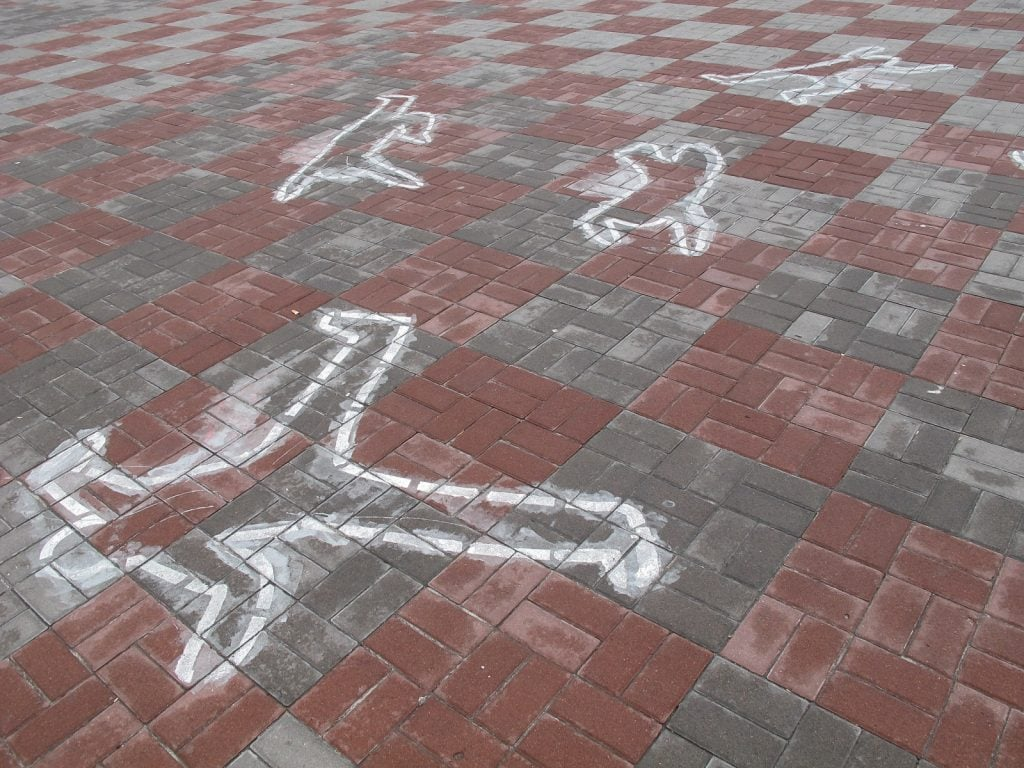 Body outlines near the stadium
