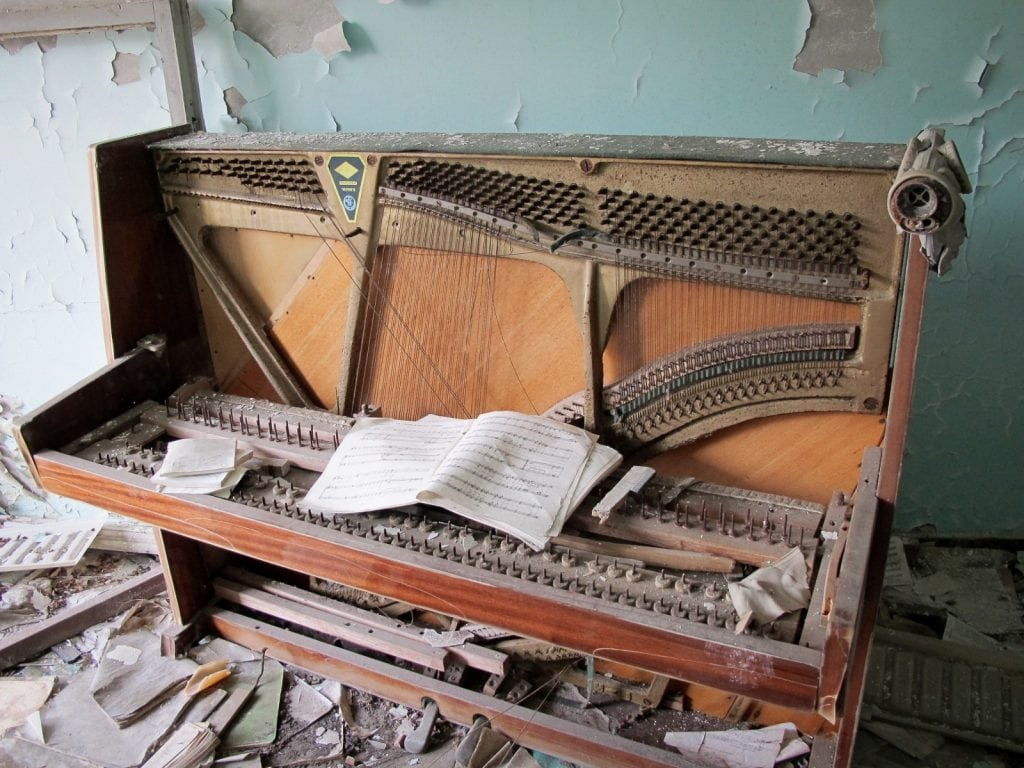 Visiting the Chernobyl Exclusion Zone; piano in Pripyat, Ukraine