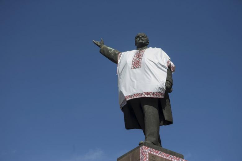 File photo of monument to Soviet state founder Lenin is decorated by unidentified people with the Ukrainian traditional shirt containing elements of the national ethnic embroidery, in the southeastern city of Zaporizhzhya, Ukraine
