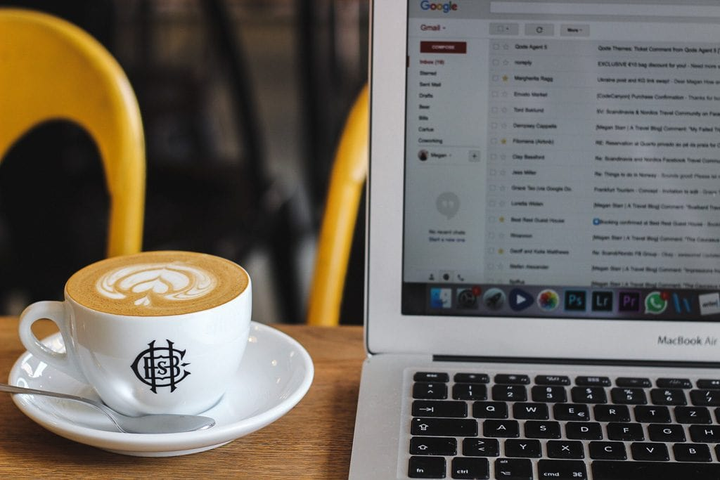 Frankfurt Cafes: The Best Coffee in Frankfurt, Germany holy cross brewing society flat white and laptop