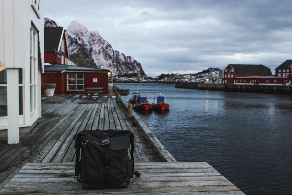 Kosan Travel Bag daypack in Henningsvær, Norway in the Lofoten Islands - the best travel bag!