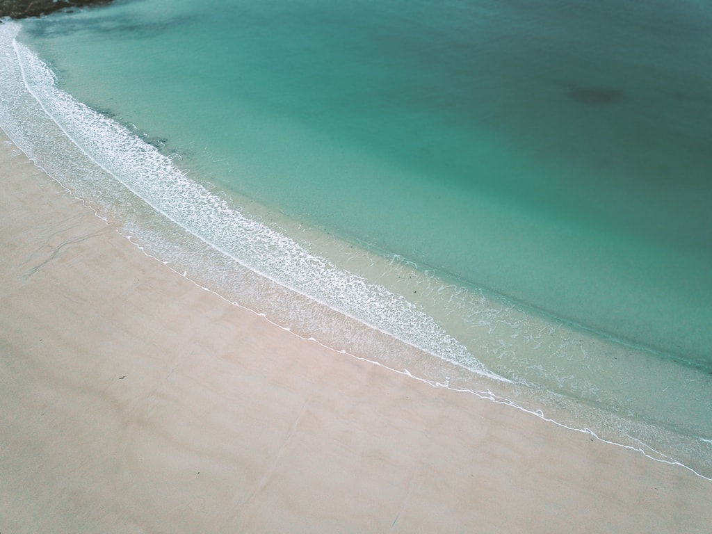 dji mavic pro aerial shot of gimsoya beach clear waters in lofoten islands norway drone