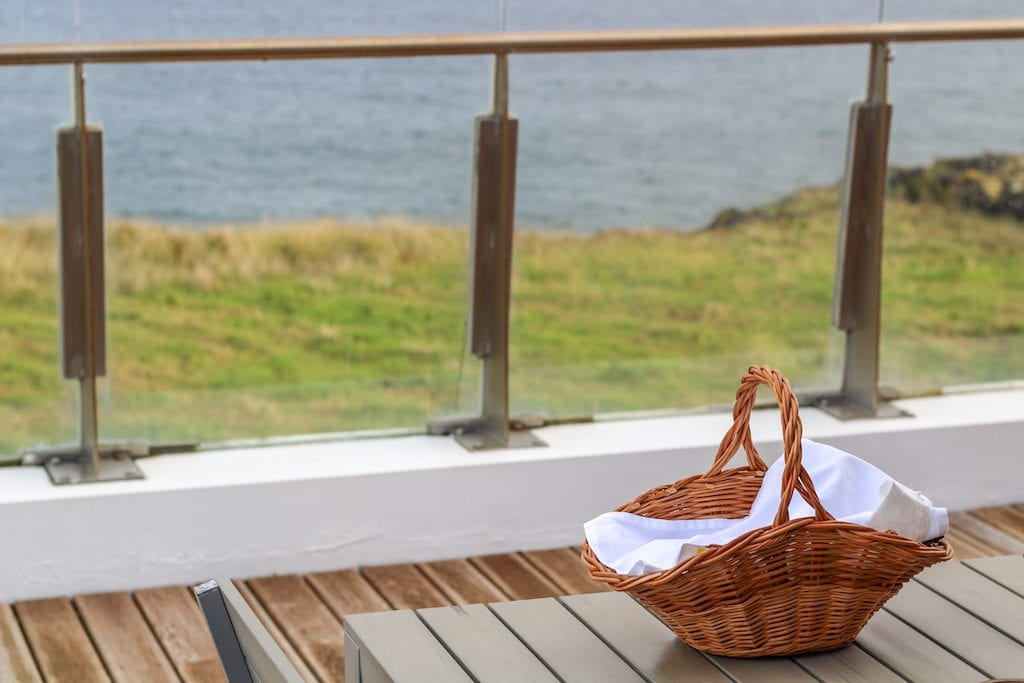 Santa Barbara Lodge by Santa Barbara Eco-Beach Resort in Sao Miguel, Azores breakfast basket with an oceanview