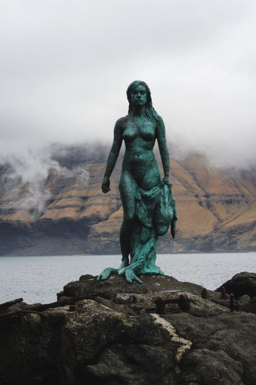 selkie seal woman statue in mikladalur on kalsoy in the faroe islands