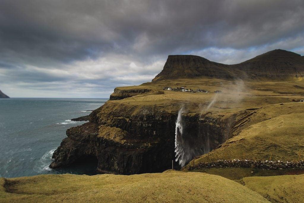 mullafossur waterfall in gasadalur faroe islands windy day