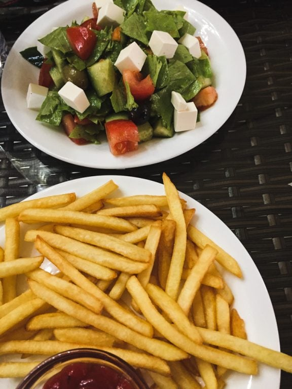 greek salad and fries in osh, kyrgyzstan
