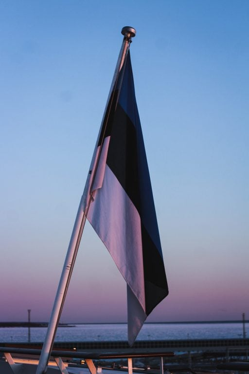 Tallinn to Helsinki Ferry: Cruising Across the Baltic Sea with Tallink Megastar estonia flag at sunrise