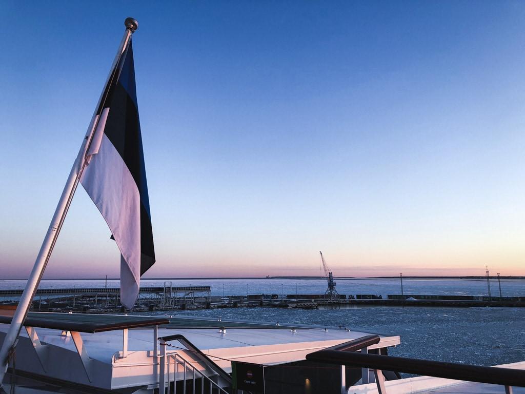 Tallinn to Helsinki Ferry: Cruising Across the Baltic Sea with Tallink Megastar estonia flag outside of ship