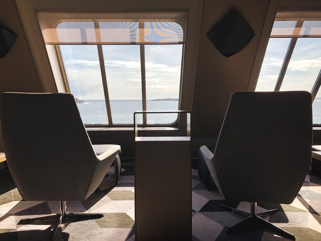 Tallinn to Helsinki Ferry: Cruising Across the Baltic Sea with Tallink Megastar lounge chairs with ocean view in business lounge