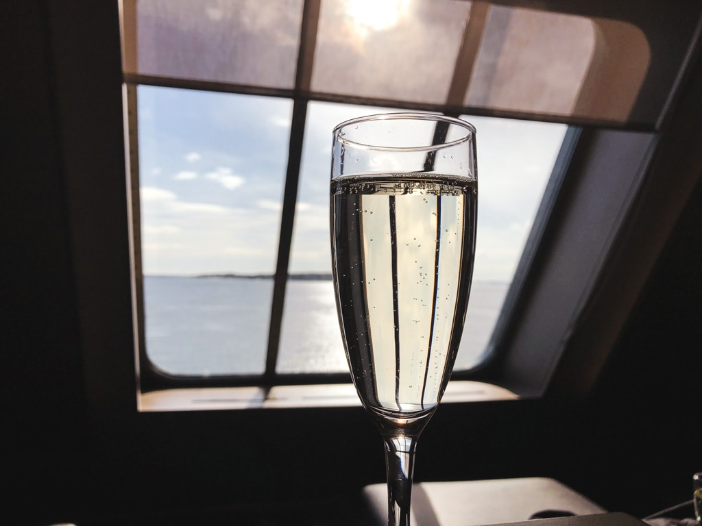 Tallinn to Helsinki Ferry: Cruising Across the Baltic Sea with Tallink Megastar champagne in business lounge with ocean view