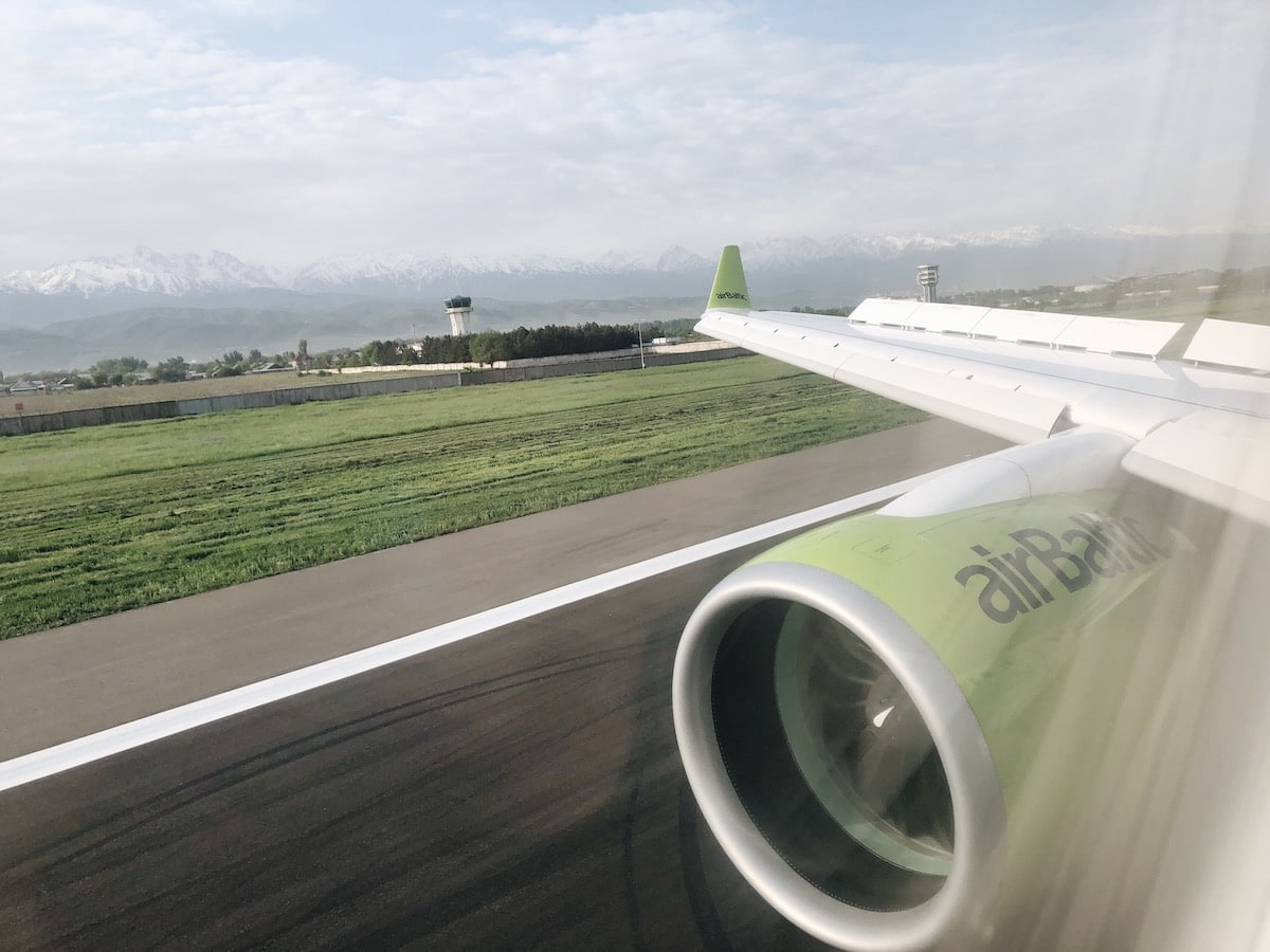Arriving at Almaty Airport with airBaltic (and What to Do Once You Land) bombardier cs300 airbaltic inside of plane