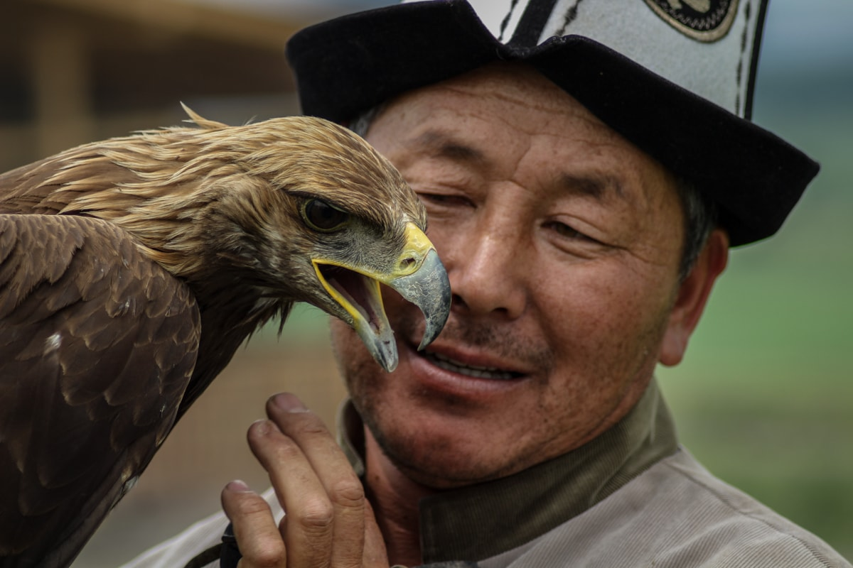 Central Asia Travel Tips: 50 Things to Know and Do Before You Visit eagle hunter in kyrgyzstan