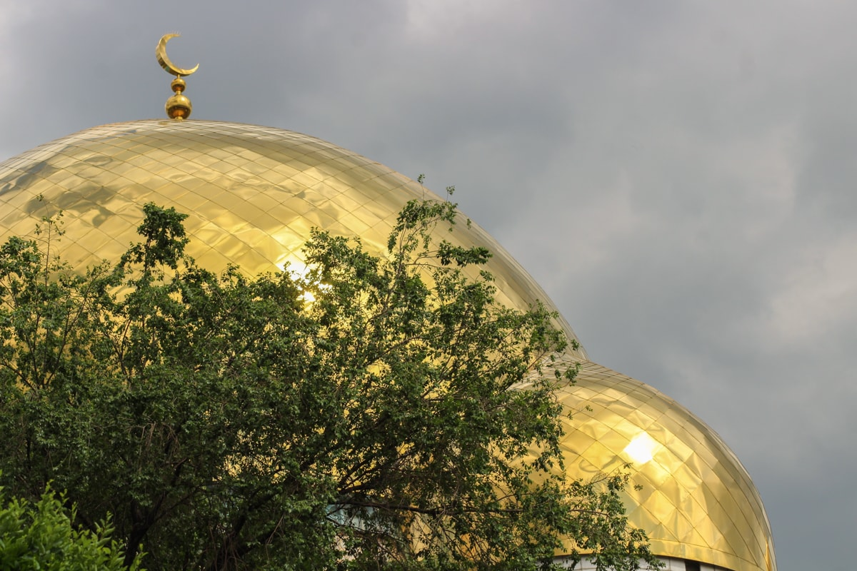 Central Asia Travel Tips: 50 Things to Know and Do Before You Visit mosque in almaty, kazakhstan near green bazaar