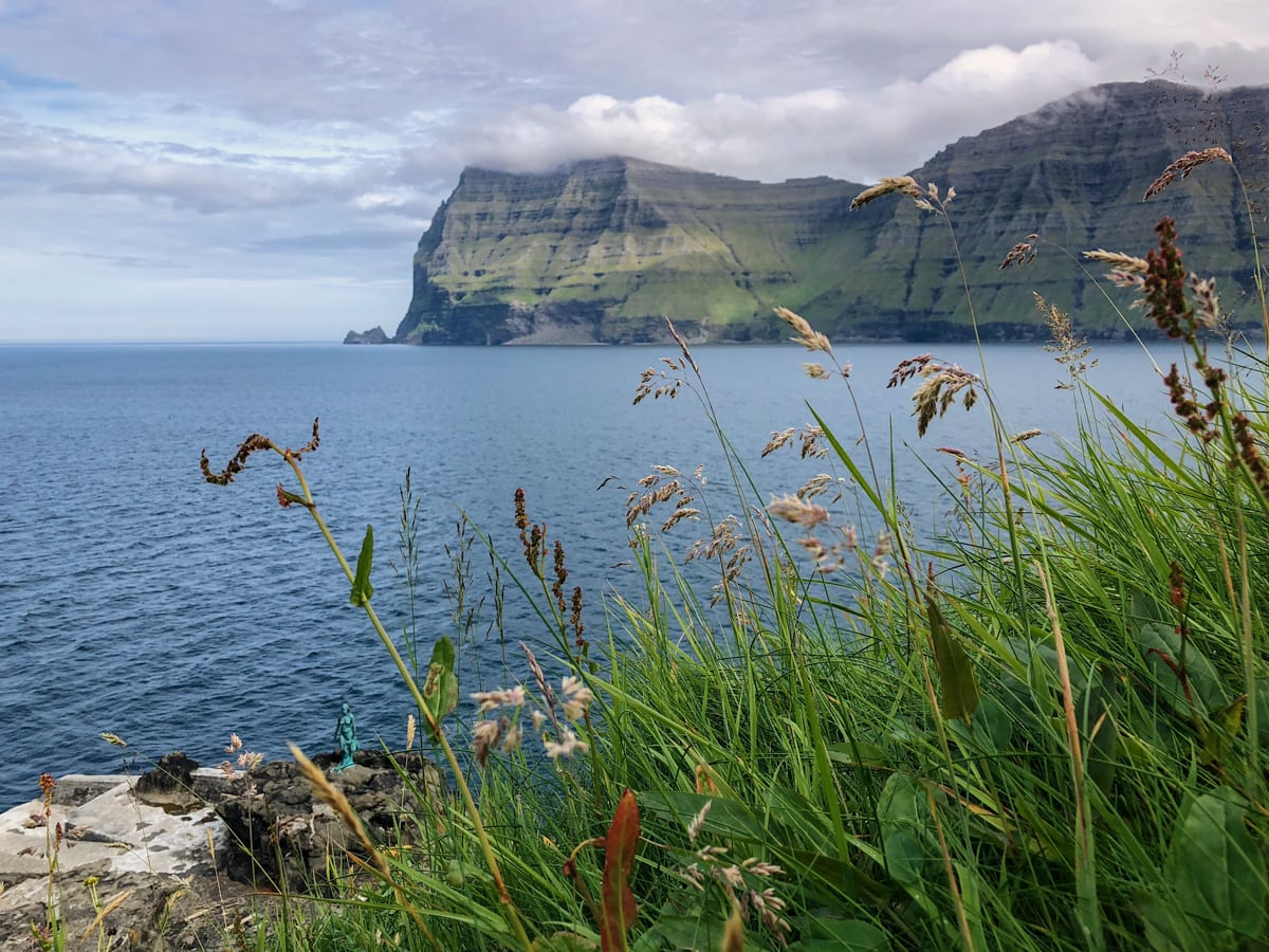 Mikladalur on Kalsoy Selkie Statue and view of Kunoy - Visit Faroe Islands: A Guide to the Best Views and Photography Spots