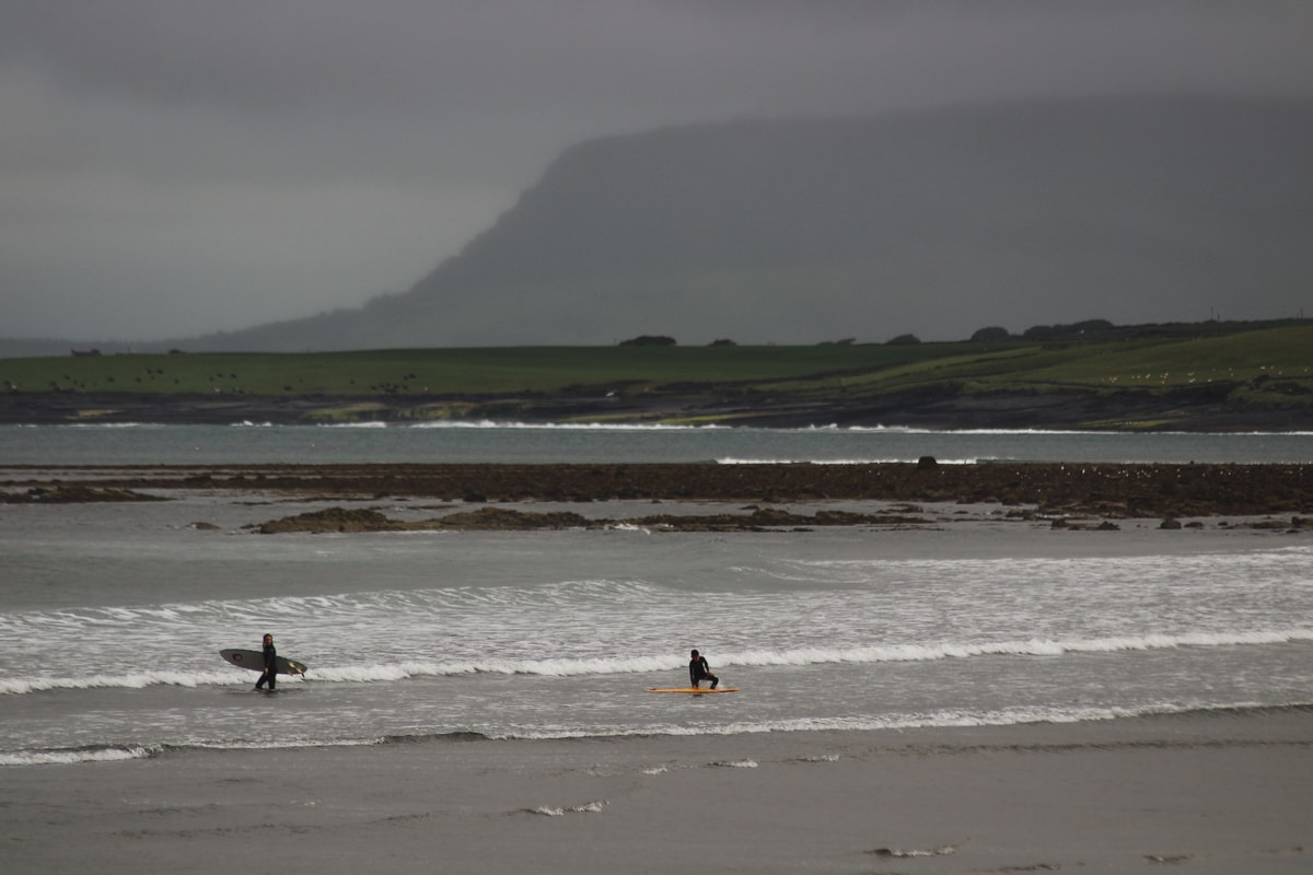 surfing at aughris in sligo ireland