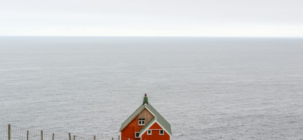 red house near akraberg lighthouse on suduroy