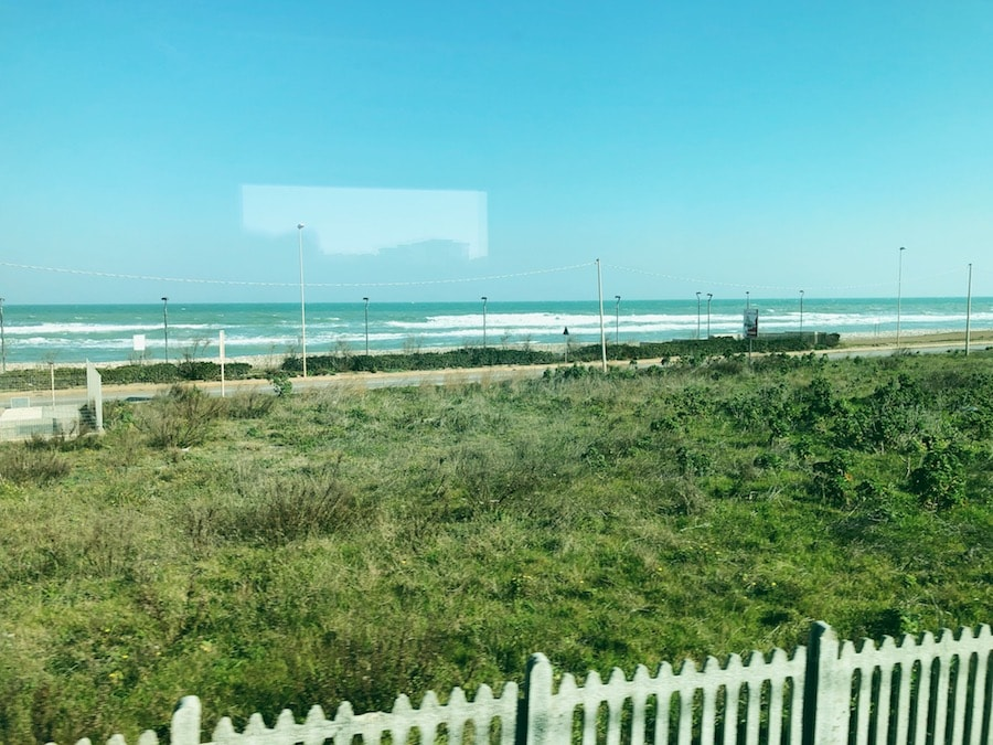 how to get from bari to polignano a mare cheaply by train random beaches in puglia
