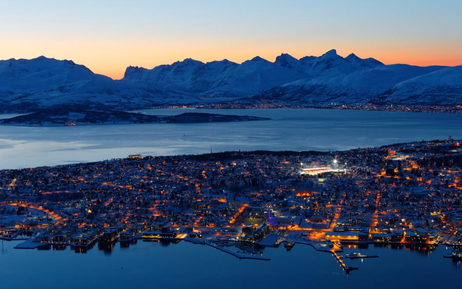 Tromsø in winter guide of things to do, places to visit, and what to do. Includes Tromsø tours and excursions, restaurants, and more!