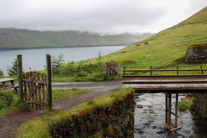 An island in the north of the Faroe Islands that often is forgotten about is Kunoy island. This is a Kunoy travel guide, including the forest on Kunoy and more.