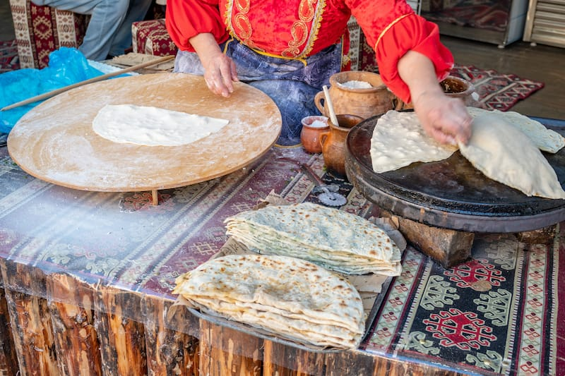 Woman making Azerbaijan Qutab with Greens