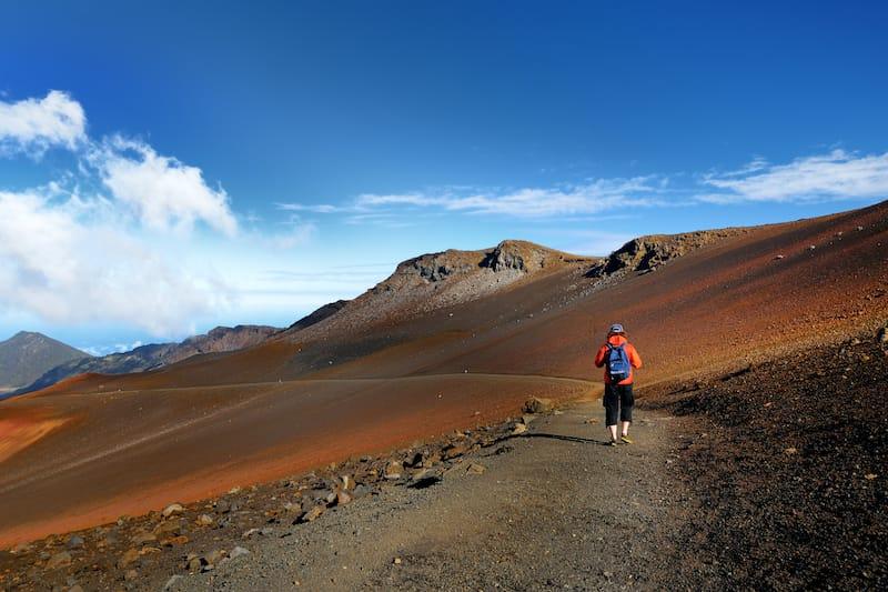Tourist hiking in Haleakala volcano crater on the Sliding Sands trail