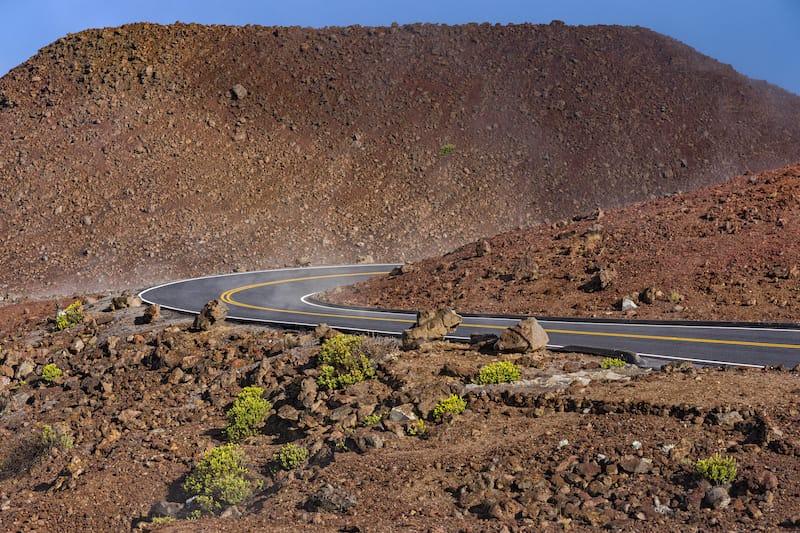 Winding Road at the summit of Haleakala National Park near the volcanic crater Maui Hawaii USA
