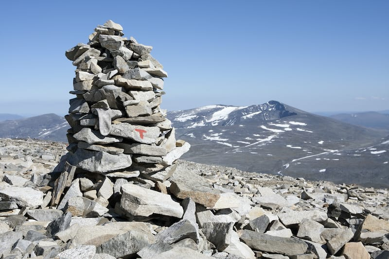 Cairn with red route T marking of the Norwegian Trekking Association (Glittertind mountain, Jotunheimen National park, Norway)