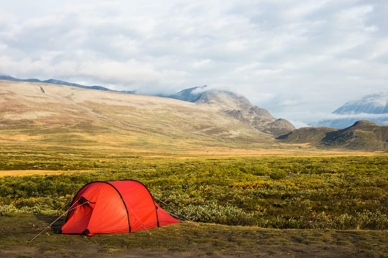 Camping in a red tent in beautiful Jotunheimen, Norway