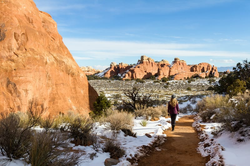 Female in Arches National Park in snow