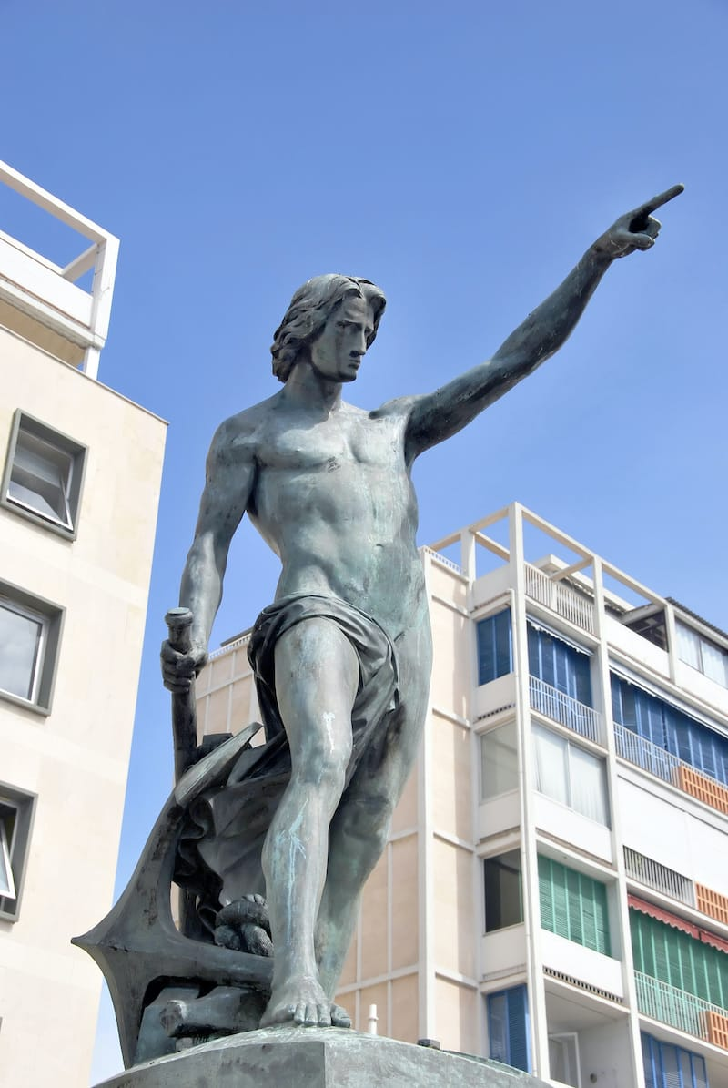 Genius of navigation. Bronze statue in Toulon, France. Blue Coast