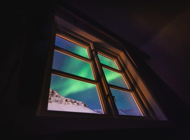 Northern lights in Svalbard window shutterstock_1262489242