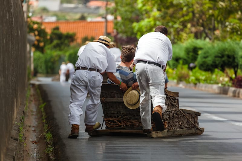 Toboggan riders on sledge in Monte - Funchal Madeira island