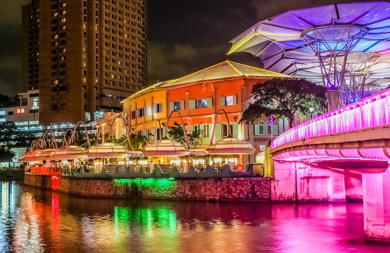 The past and the future. Night view to Clarke Quay. Singapore