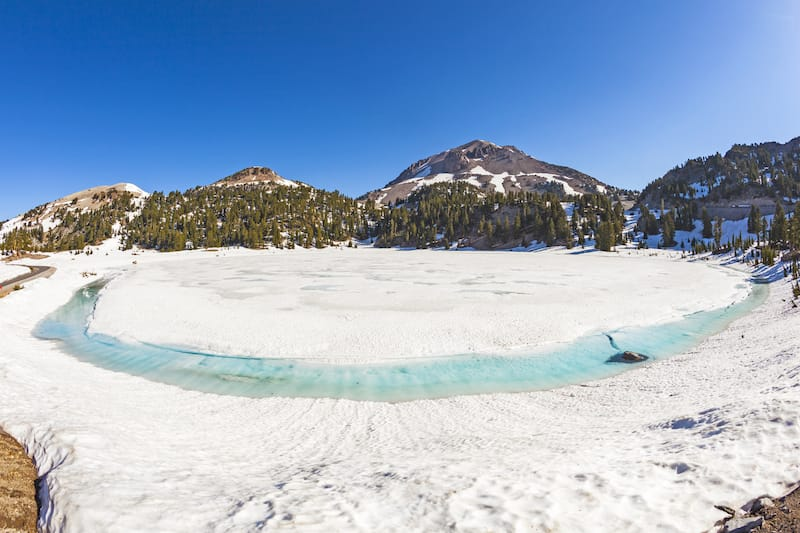 icy glacier lake on foot of Mount Lassen in the national park